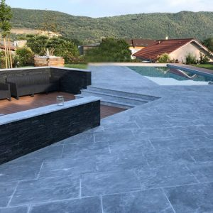 Outdoor design in natural stone, terrace, swimming pool beach, margelles, steps - Bleu of the Nil marble - Sandblasted finish